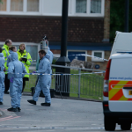 Police and forensic officers near the scene of an attack. (AP)
