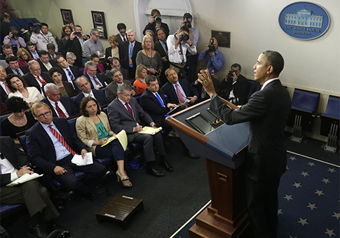 Obama answers questions during news conference in the Brady Press Briefing Room / AP