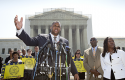 Ryan P. Haygood, director of the NAACP Legal Defense Fund, talks outside the Supreme Court / AP