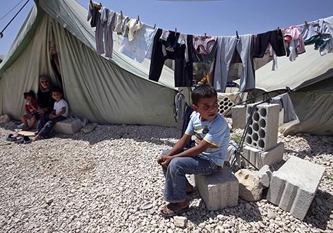 Syrian refugee family in eastern Lebanese town / AP