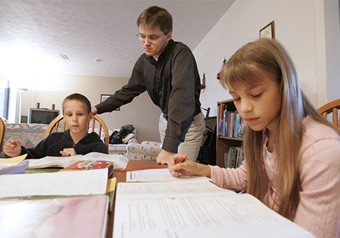 Uwe Romeike teaching two of his children in 2009 / AP