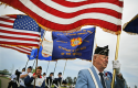 Veterans carry flags on Memorial Day in Minn. / AP