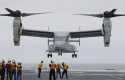 An MV-22 Osprey of the U.S. Marine Corps lands on the Japanese helicopter destroyer Hyuga during a joint exercise involving the U.S. military and Japan's Self-Defense Forces / AP