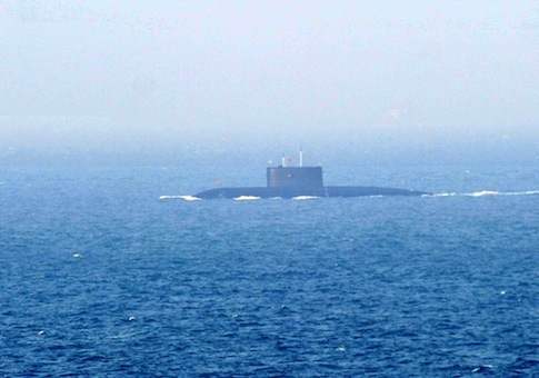 A Chinese Navy submarine sails back to a naval port in Qingdao city / AP