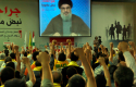 Hezbollah supporters, raise their hands in salute as Hezbollah leader Sheik Hassan Nasrallah speaks on a screen. (AP)