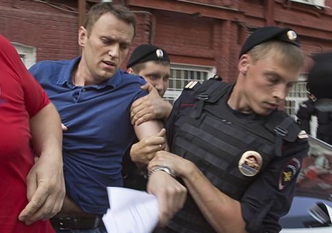 http://freebeacon.com/wp-content/uploads/2013/07/Police-officers-detain-Russian-opposition-leader-Alexei-Navalny-AP.png