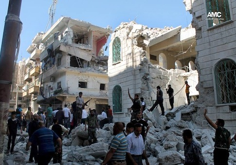 Syrian rebels inspect the rubble of damaged buildings due to a surface-to-surface missile launched by Syrian forces in Aleppo / AP