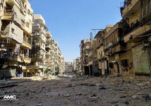 Buildings damaged by Syrian government airstrikes / AP