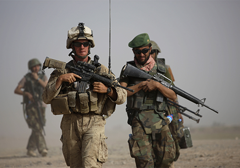 U.S. soldier and Afghan soldier / AP