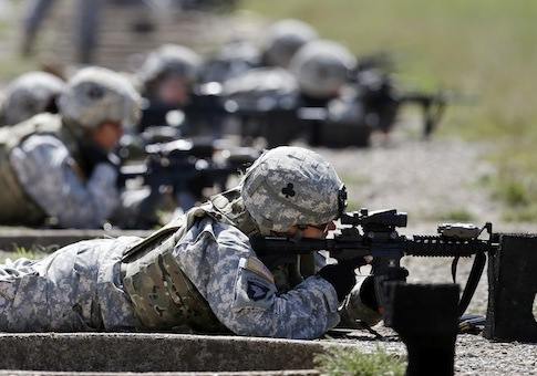 female soldiers from 1st Brigade Combat Team, 101st Airborne Division train on a firing range / AP
