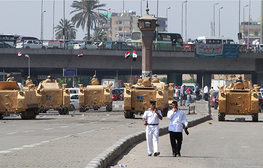 Egyptian army soldiers guard with armoured personnel carriers (APC) near Tahrir Square in Cairo August 19, 2013. REUTERS/Mohamed Abd El Ghany