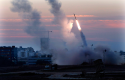 In this Nov. 15, 2012 file photo, the Iron Dome defense system fires to intercept an incoming missiles from Gaza in the port town of Ashdod, Israel. (AP)