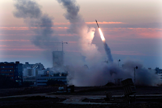 In this Nov. 15, 2012 file photo, the Iron Dome defense system fires to intercept an incoming missiles from Gaza in the port town of Ashdod, Israel / AP