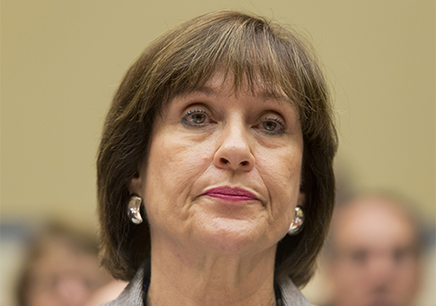 Lois Lernder was held in contempt of Congress after she refused to testify about the IRS's targeting of conservative groups. / AP