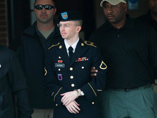 U.S. Army Pfc. Bradley Manning is escorted out of a courthouse during his court martial at Fort Meade in Maryland, August, 20, 2013. REUTERS/Jose Luis Magana