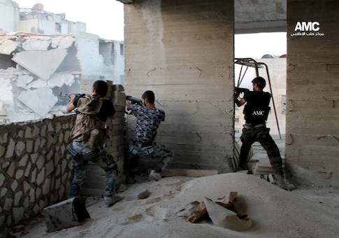 Syrian rebels open fire as they battle against the Syrian forces in Aleppo, Syria / AP