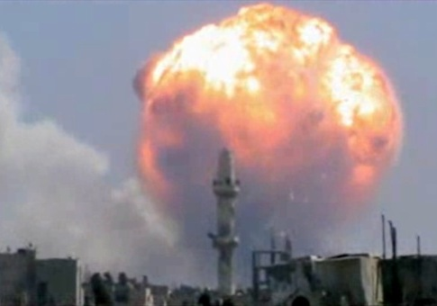 A fireball from an explosion at a weapons depot set off by rocket attacks that struck government-held districts in the central Syrian city of Homs / AP