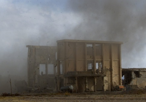 Smoke rises from an explosion in the Tornal Farms Al Qaeda training camp / AP