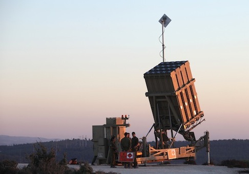Israeli soldiers are seen near an Iron Dome battery near Jerusalem / AP