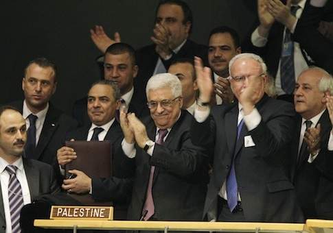 Mahmoud Abbas, members of the Palestinian delegation react during a meeting of the United Nations General Assembly in November 2012 / AP