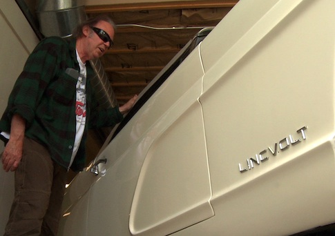 Neil Young checking out his hybrid electric 1959 Lincoln Continental  / AP