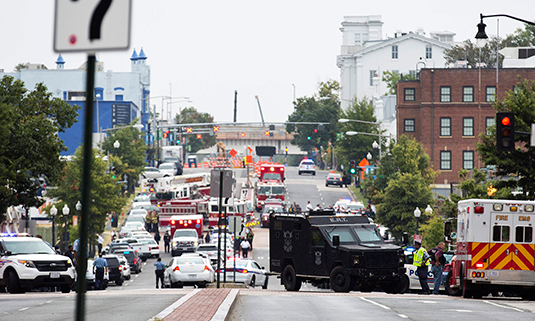 Police block off the M Street, SE, as they respond to a shooting at the Washington Navy Yard in Washington, September 16, 2013. REUTERS/Joshua Roberts