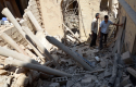 Men inspect a site hit by what activists said was shelling by forces loyal to Syria's President Bashar al-Assad, in the Duma neighbourhood of Damascus September 4, 2013. REUTERS/Bassam Khabieh