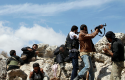 Free Syrian Army fighters fire weapons