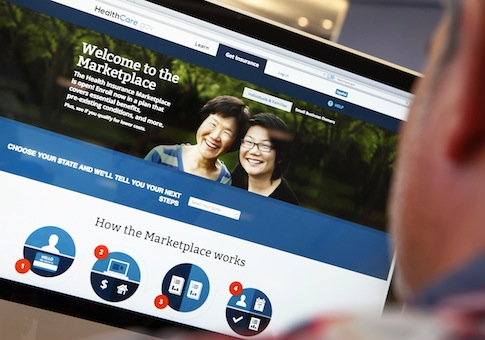 A man looks over the Affordable Care Act signup page on the HealthCare.gov website in New York in this photo illustration / Reuters