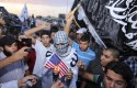 Ansar al Shariah supporters protest the U.S. capture of one of the terror group's leaders. / AP