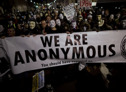 Anonymous supporters protesting in England / AP