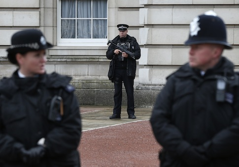 British police officers guard the grounds of Buckingham Palace in central London / AP