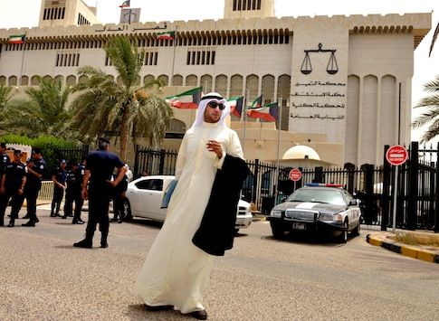 A Kuwaiti lawyer stands outside the constitutional court in Kuwait City. / AP