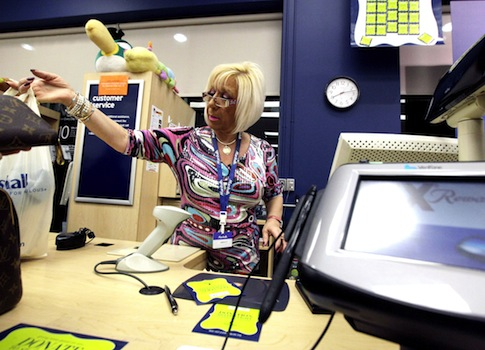 A cashier works at a Marshalls in Chicago / AP