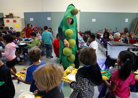 A USDA intern promotes the Farm to School program at an Oregon elementary school / AP