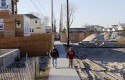 Superstorm Then And Now, Breezy Point, NY / AP