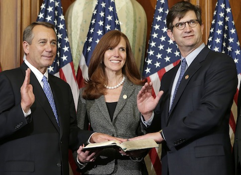 Rep. Brad Schneider, D-Ill., stands with his family for a ceremonial photo with Speaker of the House John Boehner / AP