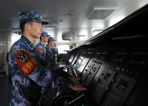 Sailors working on the Chinese aircraft carrier Liaoning / AP