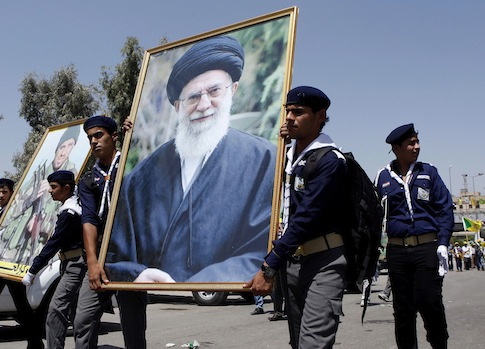 Hezbollah scouts hold up a portrait of Iran's Ayatollah Khamenei / AP