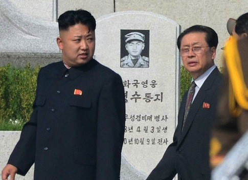 Kim Jong Un is said to have removed his uncle Jang Song Taek (R) from office