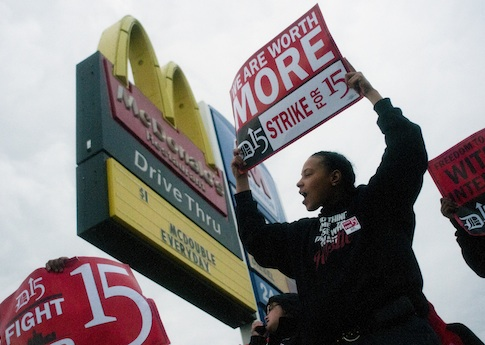 Protesters outside a McDonald's / AP