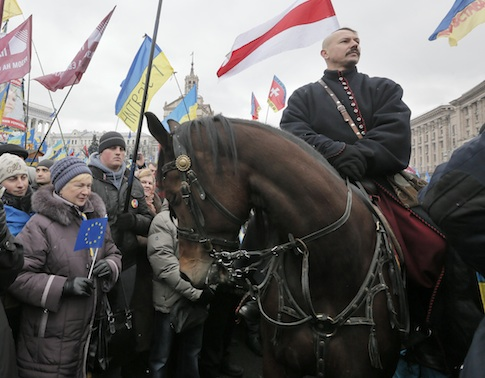 A man dressed as a Cossack on a horse pauses during the Ukrainian protests