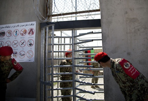Afghan National Army soldiers peek through the gate of the Parwan Detention Facility