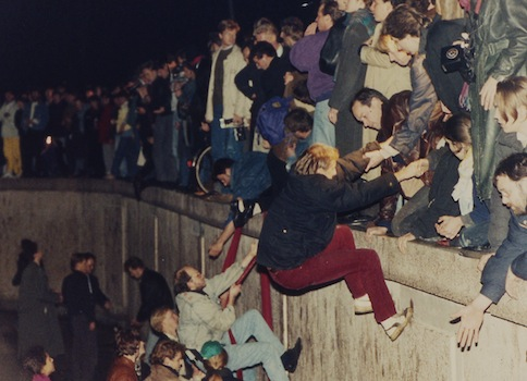 East Berliners climb over the the Berlin Wall in 1989 / AP