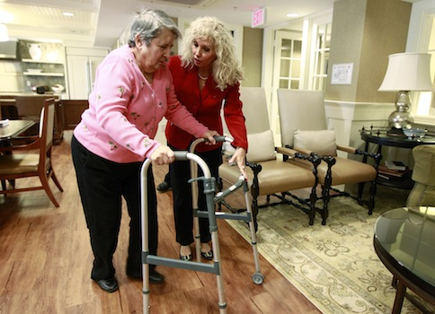 A caregiver assists an elderly dementia patient / AP