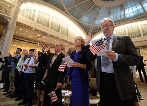 mmigrants take the oath of allegiance at a naturalization ceremony in New York