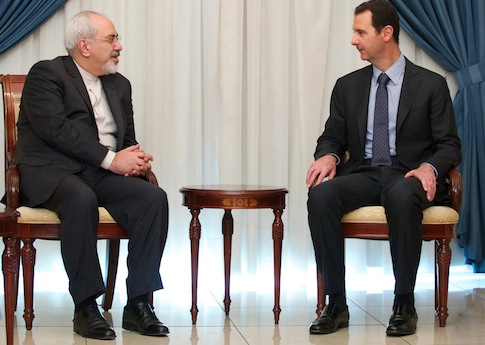 Iranian Foreign Minister Mohammad Javad Zarif  meets with Syrian President Bashar Assad Jan. 15 / AP