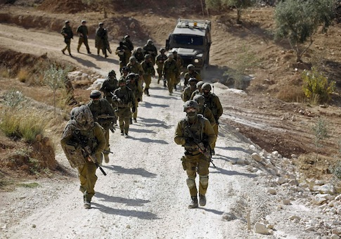 Israeli soldiers leave after an operation near Ramallah