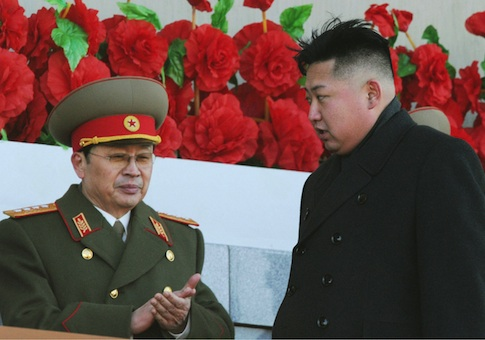Jang Song Thaek (L), uncle of North Korean leader Kim Jong Un (R) and then vice chairman of the National Defense Commission, after viewing a military parade during a ceremony to mark the 70th anniversary of the birth of the late leader and Kim's father Kim Jong Il in Pyongyang on Feb. 16, 2012