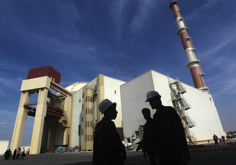 Iranian workers stand in front of Bushehr nuclear power plant